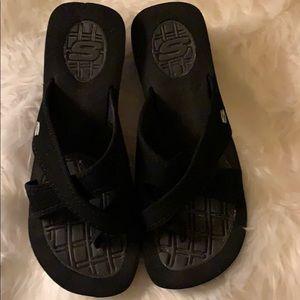 Black suede Skechers slip on wedge sandals